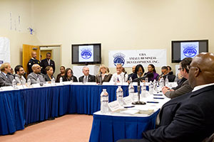 Mayor Emanuel and Chief Procurement Officer Jamie Rhee listen as business owners discuss their challenges at the Chatham Business Association Roundtable